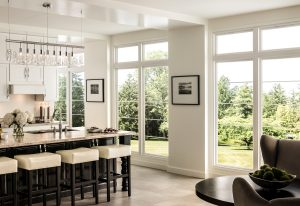 Kitchen of a modern home featuring floor-to-ceiling windows, tile flooring, and an island countertop.